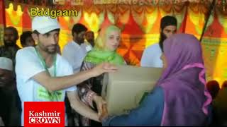 Aasha Relief Trust distributes relief amoung orphans in khan sahab badgaam (by Touqeer Ganai)