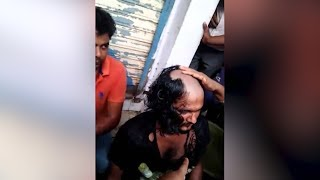 People shaved the robbers head because of police inactivity in Surat
