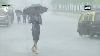 Streets waterlogged, trains delayed, as rain continues in Mumbai