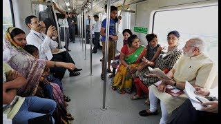 PM Narendra Modi interacts with metro commuters on his way to 26, Alipur Road