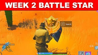 Search between an Oasis, Rock Archway and Dinosaurs LOCATION FORTNITE WEEK 2 BATTLE STAR SEASON 5