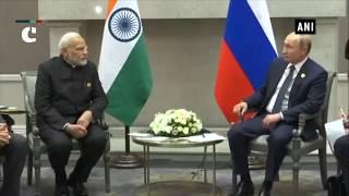 PM Modi meets Russian President on sidelines of BRICS Summit 2018