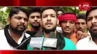 Ballia,minister of state for transport, Independente Singh, students protested against black bars.