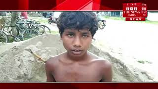 [ Assam ] Children in the construction of government roads and canals in Dhubri.