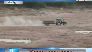 Illegal sand mining in the Orsang Riverin Chhota Udepur