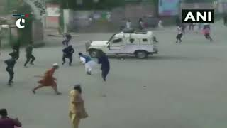 Jammu and Kashmir: Protesters pelt stones on a police vehicle & attack it with sticks in Anantnag