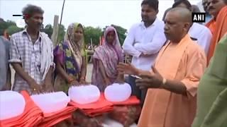 CM Yogi distributes relief material in flood-hit Barabanki