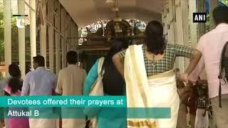 Devotees offer prayers during Onam at Attukal Bhagavathy Temple amid floods