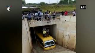 Locals rescue students stuck inside bus at swamped underpass in Rajasthan