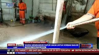 TNI-Polri Bantu Warga Bersihkan Lumpur Sisa Banjir di Padang