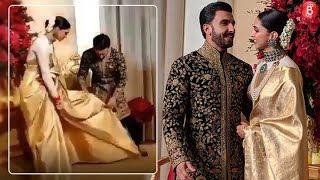 Ranveer Singh helps his ladylove Deepika adjust her saree at their Bengaluru reception