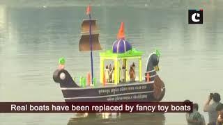 Devotees float toy boats on Kartik Purnima in Bhubaneswar