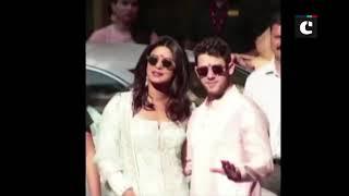 Priyanka-Nick pose after wedding puja