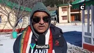 Tourists enjoying fresh snowfall at mountains of Harsil in Uttarakhand