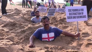 Congressman Bury Themselves In The Sand To Protest Against CRZ Notification