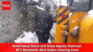 Amid heavy Rains and Snow deputy chairman M.C Baramulla Abid Salam clearing snow