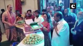 Ambani family visits Siddhivinayak, offers Akash Ambani-Shloka Mehta's wedding invitation card