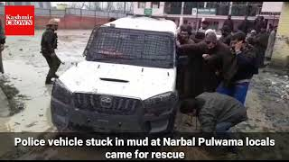 Police vehicle stuck in mud at Narbal Pulwama locals came for rescue