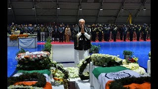 PM Shri Narendra Modi paying homage to the martyred CRPF Jawans, at Palam airport, in New Delhi