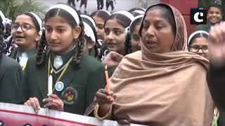 School children pay candlelight tribute to slain CRPF personnel in Punjab's Gurdaspur