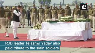 Pulwama attack Nitish Kumar, Tejashwi Yadav pay floral tribute to slain CRPF jawans in Patna