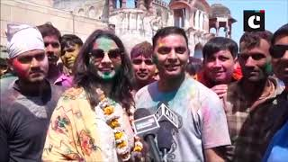 Women 'beat' men with sticks as part of Holi festivities in UP's Mathura