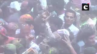 People celebrate Holi at Bankey Bihari Temple in Vrindavan