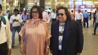 Gold Man Of Bollywood! Bappi Lahiri With His Wife Spotted At Mumbai Airport