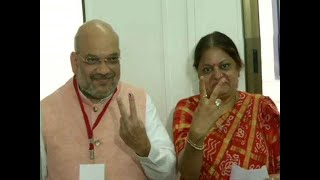Amit Shah, wife Sonal Shah cast their votes at Naranpura polling booth