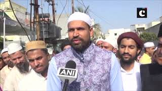 Cricketer Yusuf Pathan greets people after offering namaz on Eid-ul-Fitr