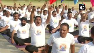 BSF personnel perform yoga near International Border ahead of International Yoga Day in Jammu