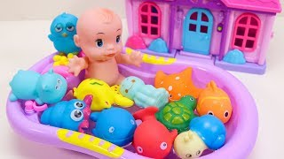 Baby Doll Playing With Sea Animal Toys And Swimming.