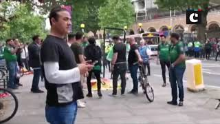 Pakistani cricket fans tear posters put up by Baloch activists in London
