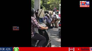 PERSON WITH OUT HELMET  FELL DOWN FROM BIKE DUE TO FEAR OF TRAFFIC POLICE AT SR NAGAR