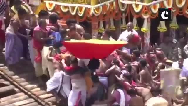 Devotees carry idols of sibling deities to Jagannath Temple in Odishas Puri