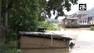 असम बाढ़: ब्रह्मपुत्र नदी खतरे के निशान से ऊपर, गुवाहाटी में आवासीय क्षेत्रों में भरा पानी