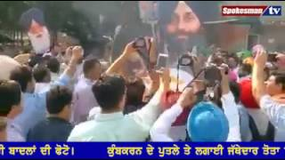 Congress workers burn Ravan with a picture of Badal