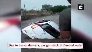Car gets stuck after heavy rains cripple Rajkot