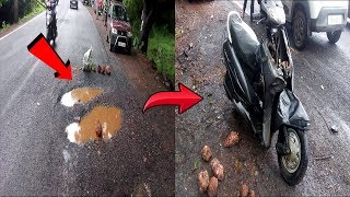 Narrow escape for woman as she falls off bike while trying to avoid pothole