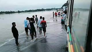 "Dhubri ""BLP"" FLOOD // A view of terrible rushing water wave acrossing road at Shankoch(Bilasipara)"
