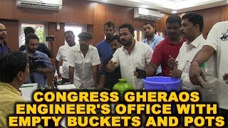 Congress gheraos engineer's office with empty buckets and pots