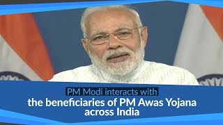 PM Modi interacts with the beneficiaries of Pradhan Mantri Awas Yojana from across India, via VC
