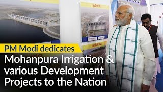 PM Modi unveils plaque to mark the dedication of Mohanpura Irrigation & other projects to the Nation