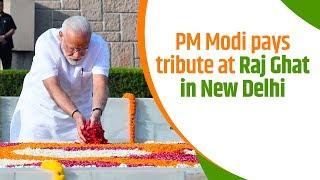 PM Modi pays tribute at Raj Ghat in New Delhi   PMO