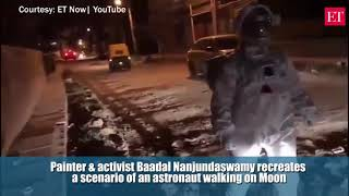 Watch: Artist dressed up as Astronaut Moonwalks on crater-size potholes in Bengaluru