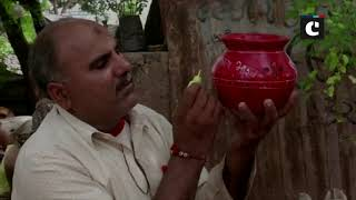 Navratri 2019: Artist decorates 'garba' pots with message of Article 370