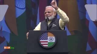 PM Modi presents Friend of India, President Donald Trump, to the historic #HowdyModi in Houston