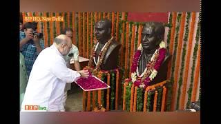 Shri Amit Shah pays floral tributes to Deendayal Upadhyaya on his birth anniversary at BJP HQ.