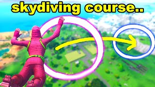 COMPLETE THE SKYDIVING COURSE OVER FATAL FIELDS AFTER JUMPING FROM THE BATTLE BUS FORTNITE