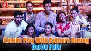 Ajay Devgn, Karan Johar, Rani Mukerji, Tannisha Mukerji, Kajol Play With Colours During Durga Puja